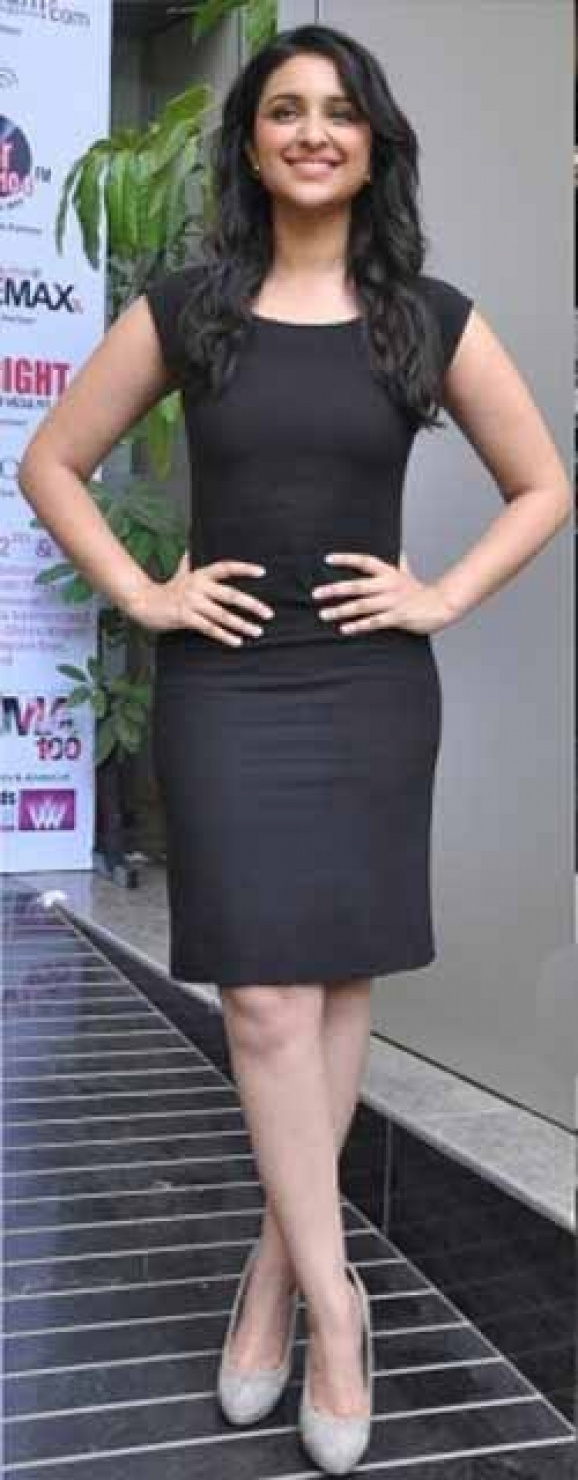 Style Check!!! Our very own bubbly and cute Parineeti Chopra looks stunning in this DKNY Sheath Dress.