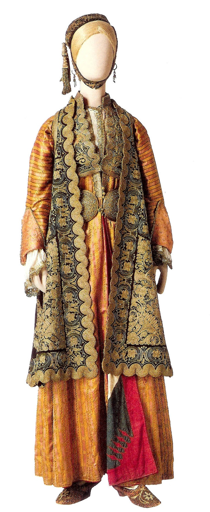 Costume of a noblewoman from Ioannina. The gown called a Kavadi , podies , waistcoat , sleeveless open over coat pirpiri and a small fez called a kapitseli. The slippers decorated with pearls. 18th c