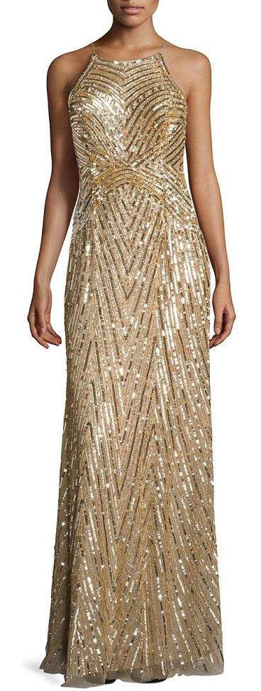 metallic beaded gown by Aidan Mattox. Glamorous gown will allover bead embellishments. Halter straps. Back keyhole with hook-and-eye closure. Back zip clos...