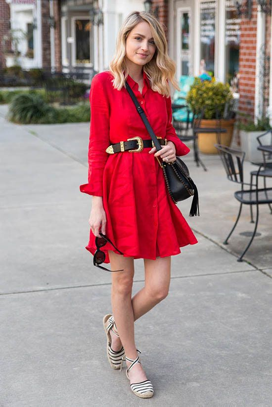 street style - The Top Blogger Looks Of The Week: Fashion Blogger 'The Little Blonde Book' wearing a red shirt dress, a black double buckle western belt, a black tassel shoulder bag, black and white espadrille sandals and black sunglasses - summer outfit - beach outfit - festival outfit - boho chic outfit