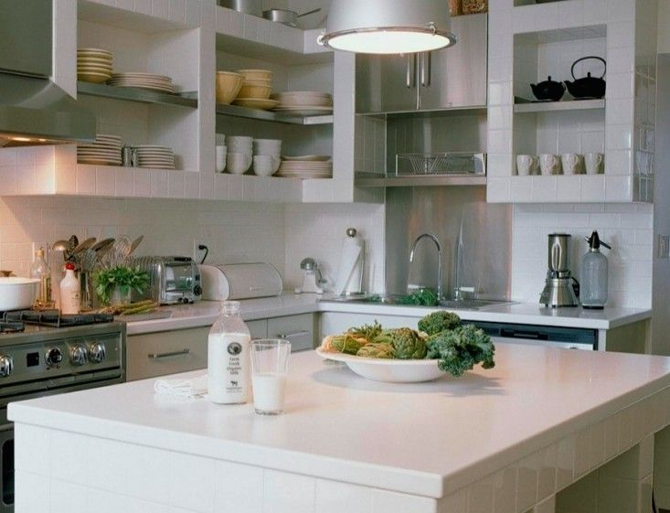 A kitchen in Boston with tiled shelves and island base. Photograph by Antoine Bootz.