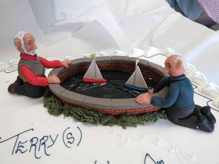 Sugarpaste Model of two retired gentlemen sailing their boats.