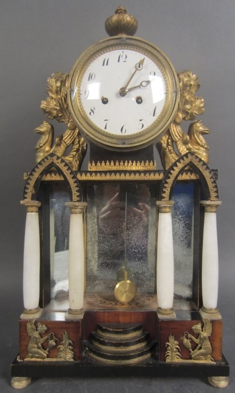 Gilt wood, mahogany, and marble clock with mirror and painted details. Biedermeier, 19th CenturyHeight: 19, Width: 10