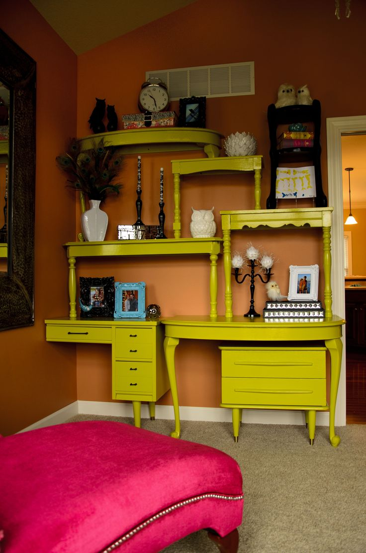 Think outside the box for storage/design solutions! You can build a shelving unit like this for less than fifty bucks (even less if your tables are roadside rescues).