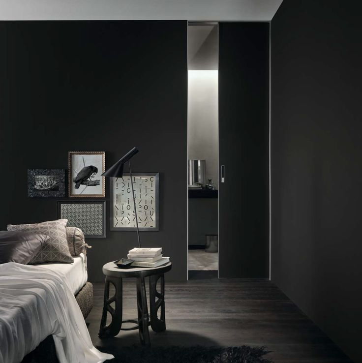 Moon door sliding into the wall, brushed peltro structure and black mat lacquered glass.