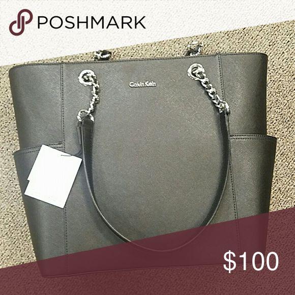 NWT Calvin Klein handbag Large lack handbag pockets on sides. Two insode pockets and zipper pocket to split inside. Calvin Klein Bags Shoulder Bags