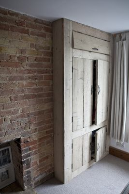 Built in wardrobe / clothing storage made of aged, scarred and rustic reclaimed wood. So chunky and gorgeous. I love how much character old wood has.