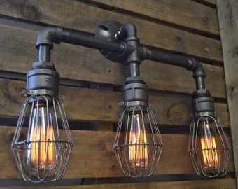 Triple Industrial Pipe Adjustable Wall Light  by WestNinthVintage