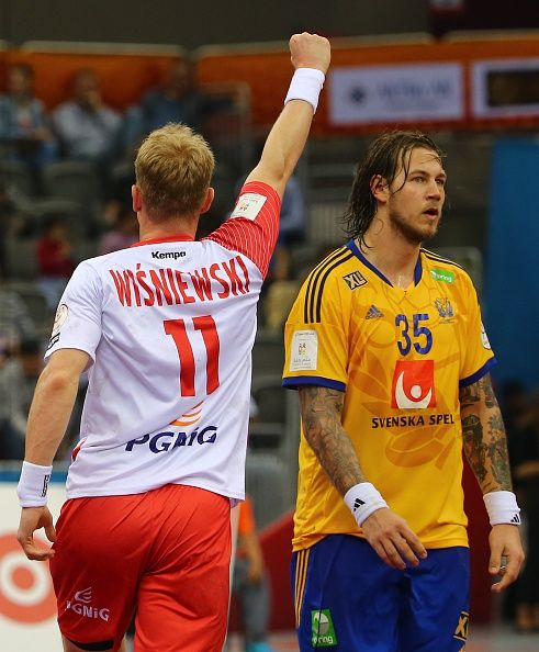 Poland's Adam Wisniewski celebrates a goal as Sweden's Andreas Nilsson looks on during the 24th Men's Handball World Championships Eighth Final EF2...