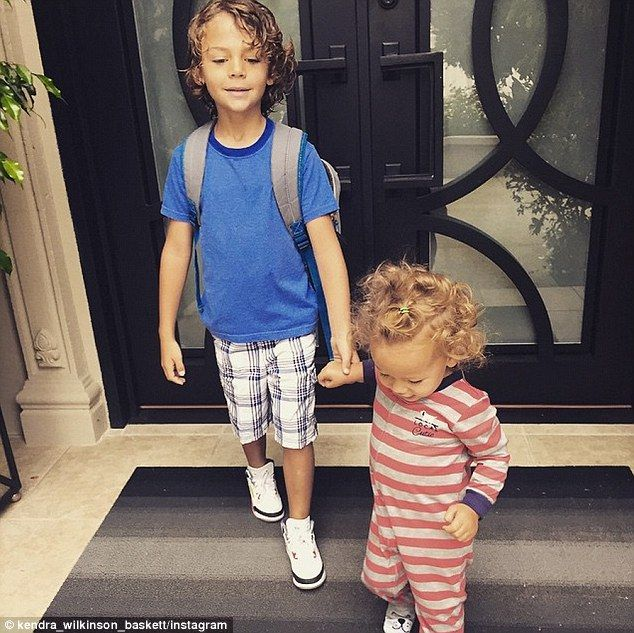 Watershed: Kendra Wilkinson and Hank Baskett took their oldest child Hank IV to his first day at Kindergarten on Wednesday, assisted by their one-year-old daughter Alijah