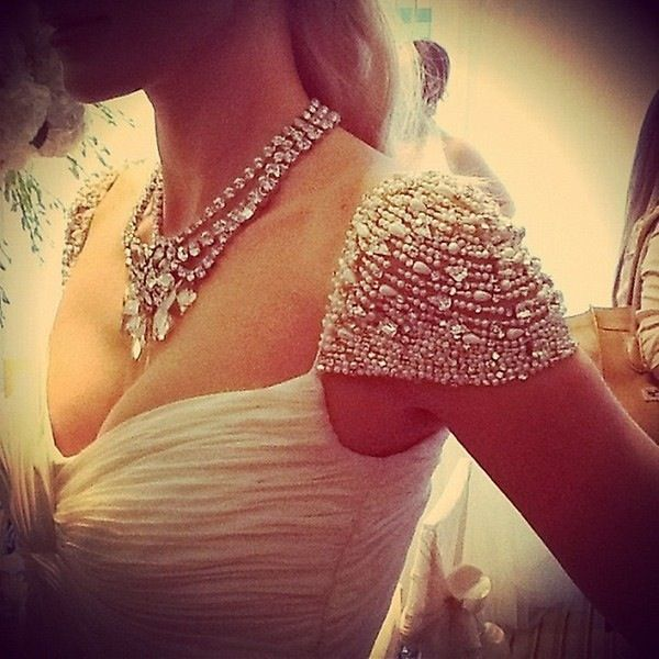 beaded cap sleeve wedding gown.