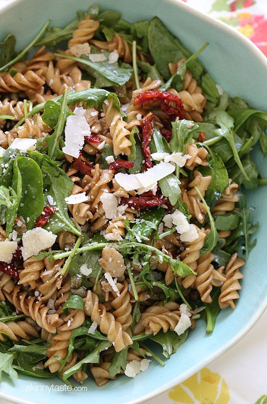 Summer Pasta Salad with Baby Greens – I love making this mayo-less pasta salad with a good does of greens, sun dried tomatoes, capers, fresh shaved Parmesan cheese and a splash of balsamic and oil. #meatlessmondays #weightwatchers #vegetarian #cleaneats
