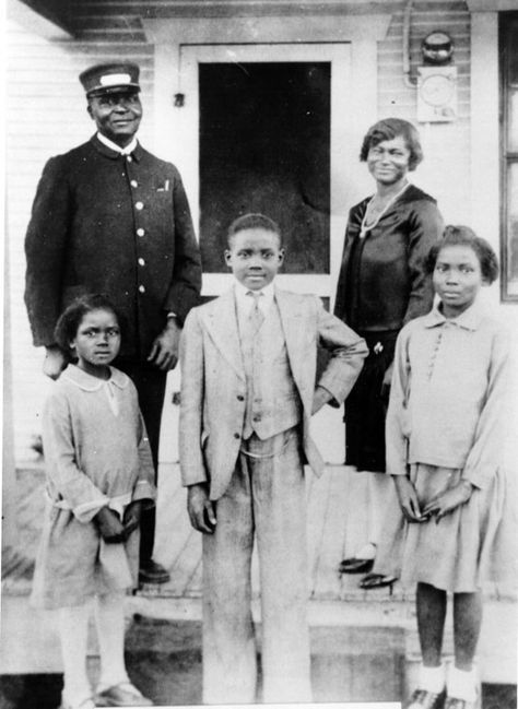 The Warren family pose on their front porch in Fort Worth, Texas. L to R, top, William, a Pullman porter, his wife Carrie and children, Alma, Alton, Elnora. ca. 1930, Shades of L.A.: African American Community, LA Public Library.