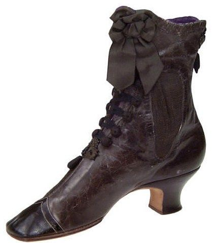 Lovely black Victorian boot with button closure and a bow at the ankle.