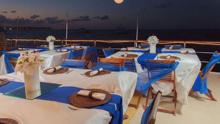 Table settings for a romantic evening wedding aboard the La Barcaza Wedding and Party Boat in Punta Cana.
