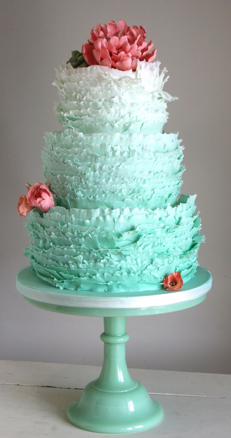 A sea-foam green 12 ombre colour ruffle cake, finished with sugar peonies and a tiny sugar succulent
