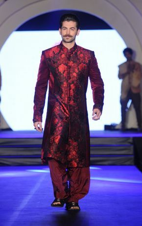 Neil Nitin Mukesh in red floral burgundy sherwani by Rohit Verma. More photos - http://www.indianweddingsite.com/marigold-watches-rohit-verma-fashion-show/