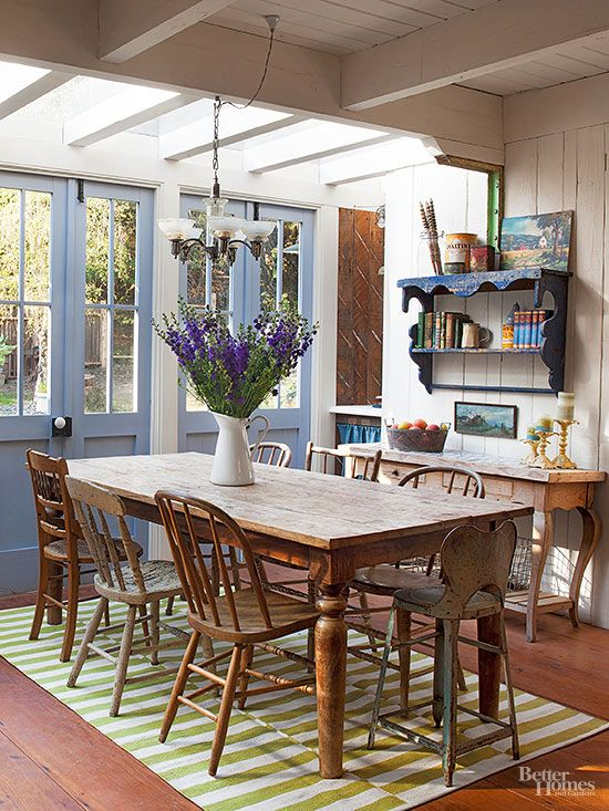 Streaming sunshine is nearly all the decoration this breakfast room needs, with the morning sun serving as a wake-up call. A long-loved table with a mismatched set of chairs, as well as wide-plank wood walls and homey white paint, create the ideal setting for the start to a day in the country./