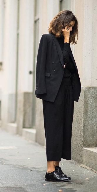 Wallpaper* fashion director Isabelle Kountoure in a black blazer, culottes, and oxfords