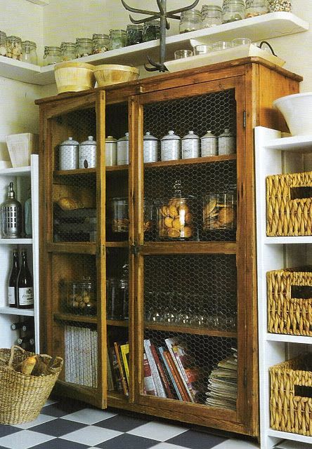 Pantry with modern shelving and a vintage chicken wire cabinet.linenandlavender.blogspot.com
