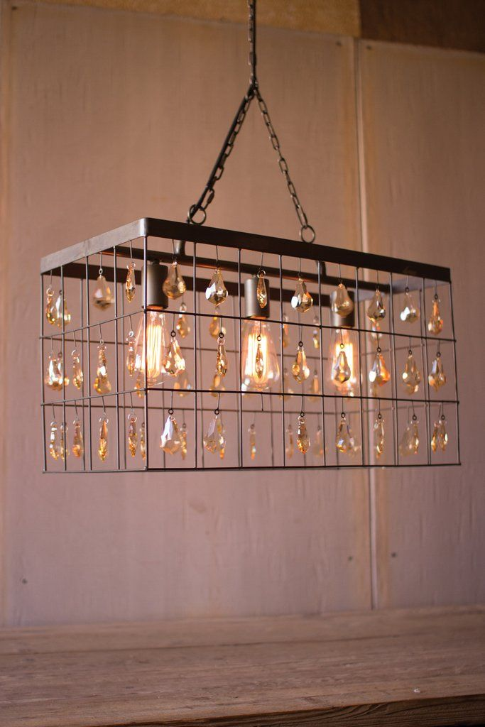 Add a little glam to your home with this large rectangular pendant. This  gorgeous light
