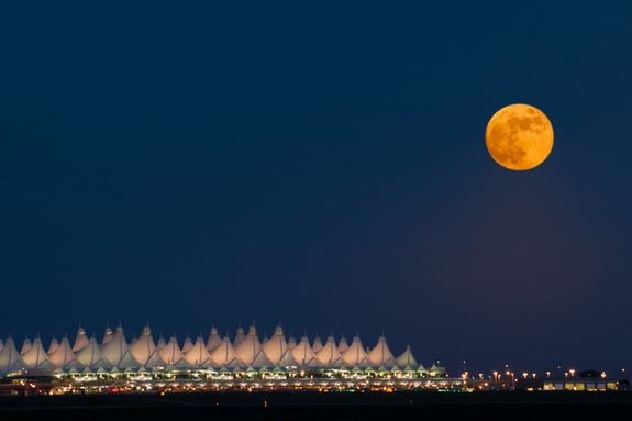 This spectacular shot of a full moon over the Denver International Airport in Colorado was taken on June 15th, 2011.