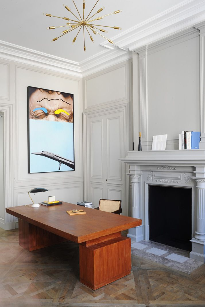 A Private Apartment by Joseph Dirand In Saint-Germain-des-Prés, Paris, France | In the office, under a chandelier by Gino Sarfatti (Galerie Kreo), hangs an artwork by John Baldessari that dialogues directly with a desk by Pierre Jeanneret (Galerie Dutko). Desk lamp by Bruno Gatta (Galerie Kreo).  Photo © Adrien Dirand / AD France n° 119, September/October 2013.http://www.yatzer.com/joseph-dirand-saint-germain-paris