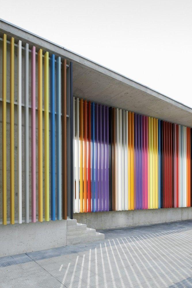 The colourful facade presents a public piece of art