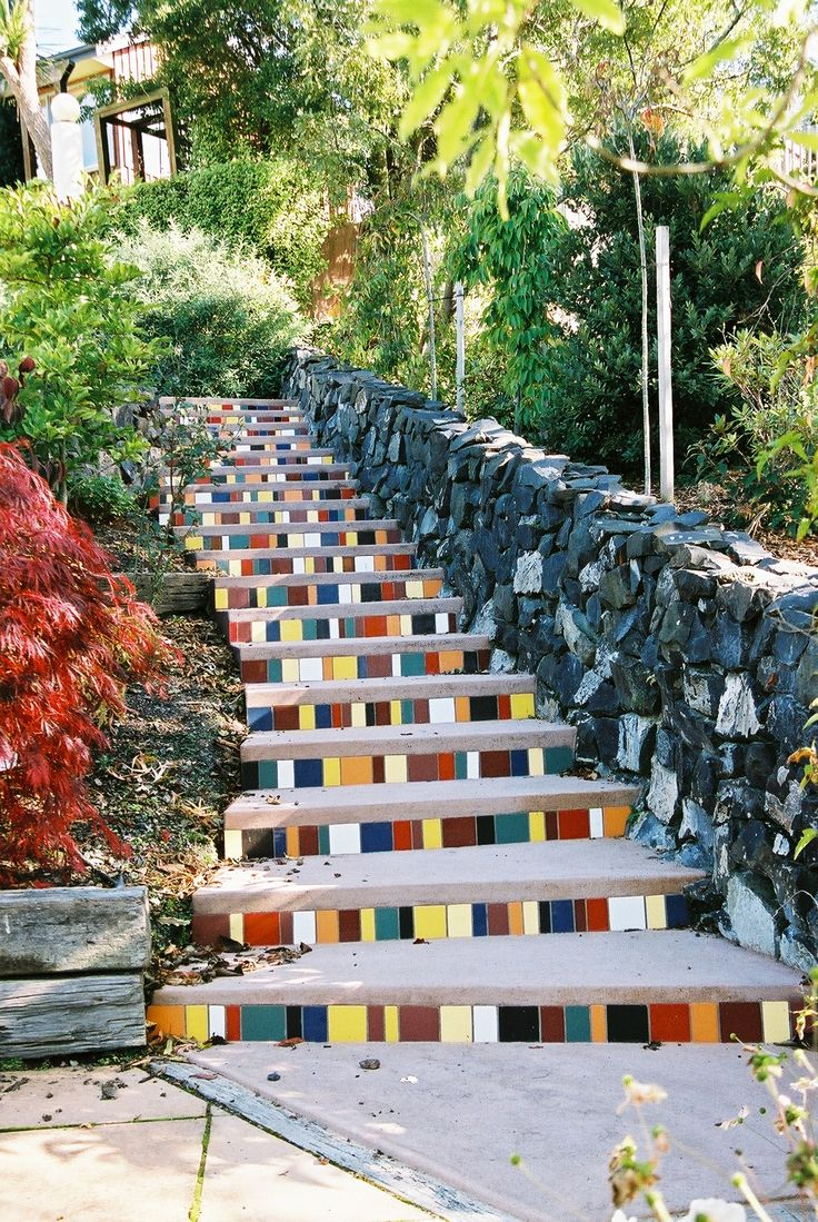 Mosaic risers add personality to this set of stairs.
