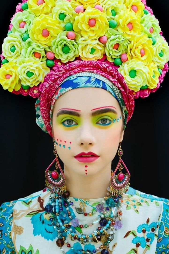 From the bright beads to the bold makeup to the bouquets balanced as exuberant crowns, these photographs by Ula Kóska are rich with color, pattern, and tex
