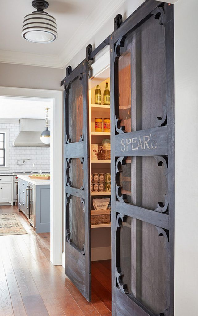 Pantry doors. Pantry antique door hung with barn door hardware. Antique doors look even better if installed as sliding #barndoors. These add a #rustic charm to this #farmhousekitchen and #pantry. Kristina Crestin Design