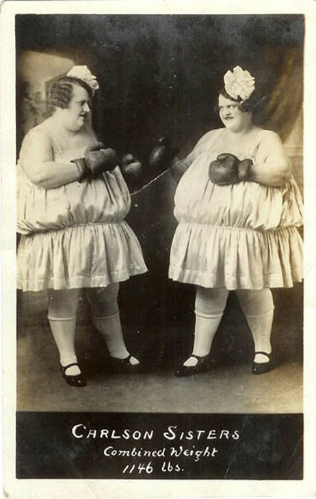 The Carlson Sisters as side show act as fat lady twins.  They put on a boxing match for paying customers.