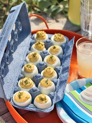 Deviled Eggs - easier to transport ------Cover in plastic wrap first to protect against germs!!! You could use the plastic or Styrofoam egg crates and wash them first...I would still cover with plastic wrap (it takes 2 seconds and why risk anyone getting sick?) because it is not worth taking the the risk, in my opinion :)
