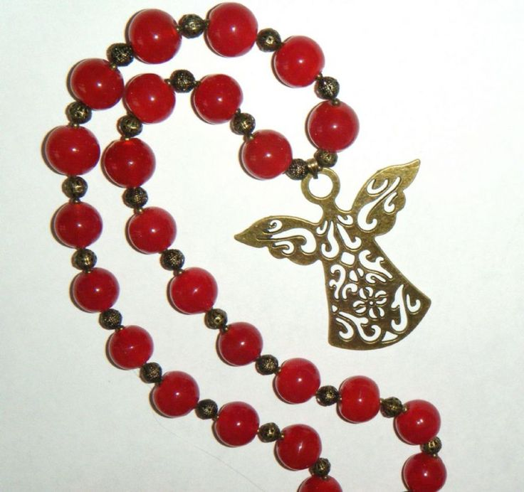"""Large brass angel pendant on cherry red glass bead necklace 28.1/2"""" long (72.5cm)."""