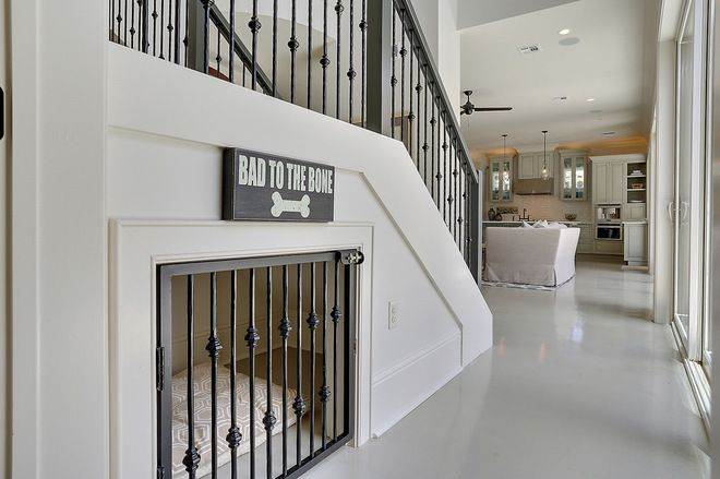 Use understair storage as an attractive den for your doggy. A matching railing helps this gate blend seamlessly with the decor.