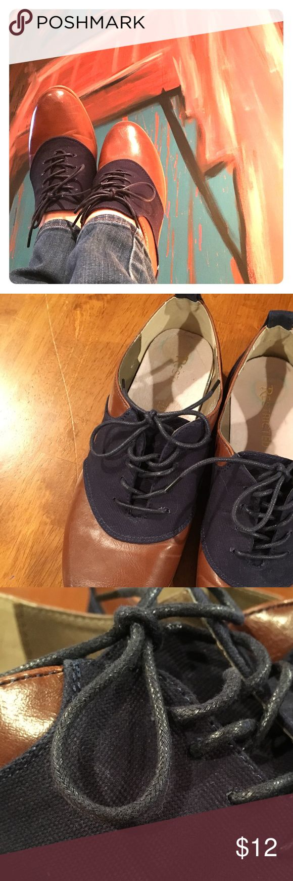 Brown & Navy Saddle Oxfords This ad is for an adorable pair of ladies size 8 saddle Oxford shoes.  Brown with navy corduroy and shoestrings.   Gently worn in great condition.  Fits true size 8 Restricted Shoes Flats & Loafers