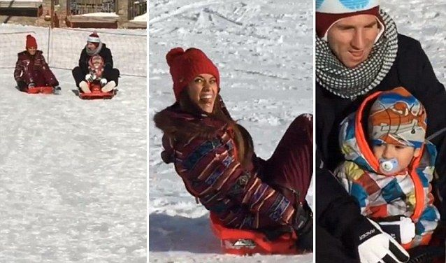 Barcelona star Lionel Messi enjoys sledging in the snow with his wife Antonella Roccuzzo and son Thiago.