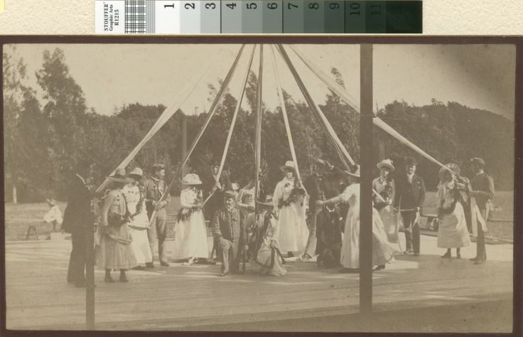 May Pole dance held on campus of St. Matthews School, later site of San Mateo Junior College. Occasion was a guild bazaar about 1888-1890. Standing l to right Mable Lawrence, May Greene, Mary Morse, Grace Lawrence, Frances Soule, Mrs. Della Morse, Directress; Miss. Watson, kneeling - Edith Bartlett. (Baldwin Avenue)