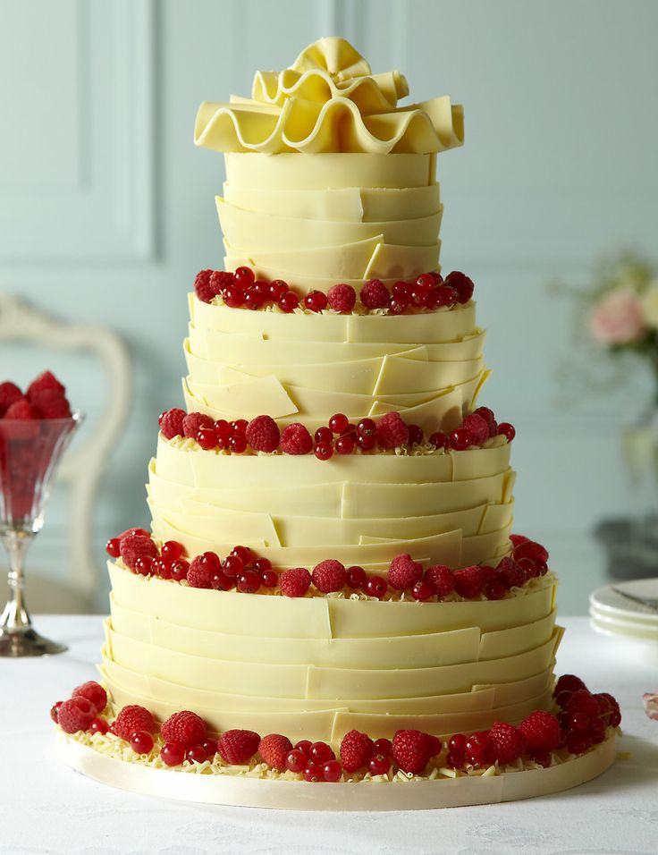 From Marks Spencer This 4 Tier White Chocolate Wedding Cake Is Smothered In Ganache And Hand Finished With