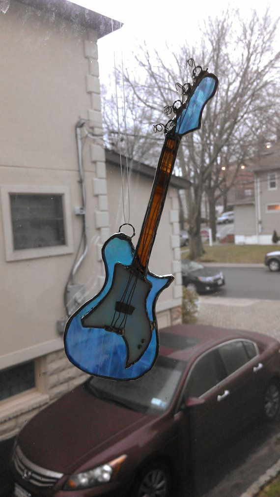 Hey, I found this really awesome Etsy listing at http://www.etsy.com/listing/126826558/stained-glass-electric-bass-guitar