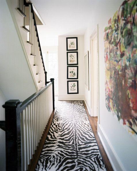 Hallway - A hallway with a zebra-print runner