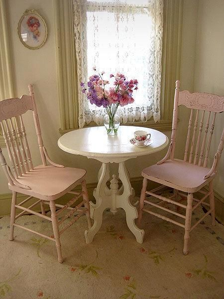 Cute little round white table with pastel chairs. Shabby chic