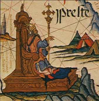 """Preste"" as the Emperor of Ethiopia, enthroned on a map of East Africa in an atlas prepared by the Portuguese for Queen Mary, 1558. (British Library)"