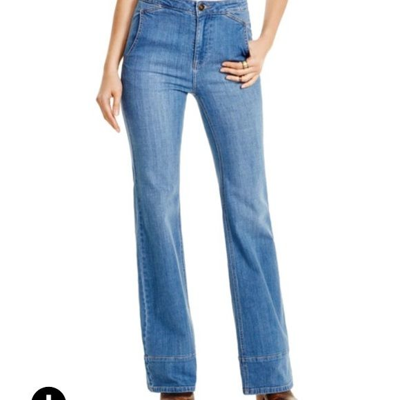 """Free People Wide leg jeans Free People's wide leg jean's retro-cool cut with fresh flattering appeal. Zip fly with button closure, belt loops, buckle adjuster at back waist, side slit pockets, high rise. Contrast stitching. Gold-tone hardware with light fading.  Cotton/spandex. Machine wash. 11"""" rise; 33"""" inseam, 12"""" leg opening Free People Jeans"""