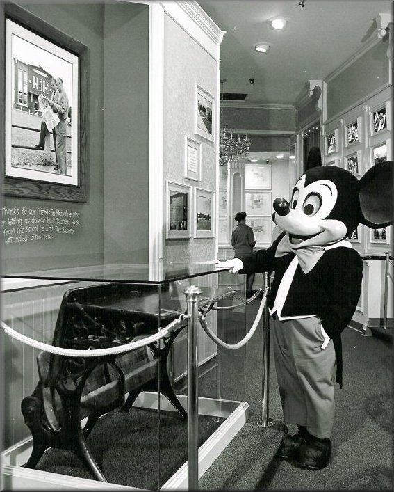 Vintage Disneyland. Mickey admiring a school desk from the school in  Marceline that Walt & Roy once attended.