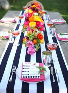 Custom black-and-white-striped runners with bright florals.