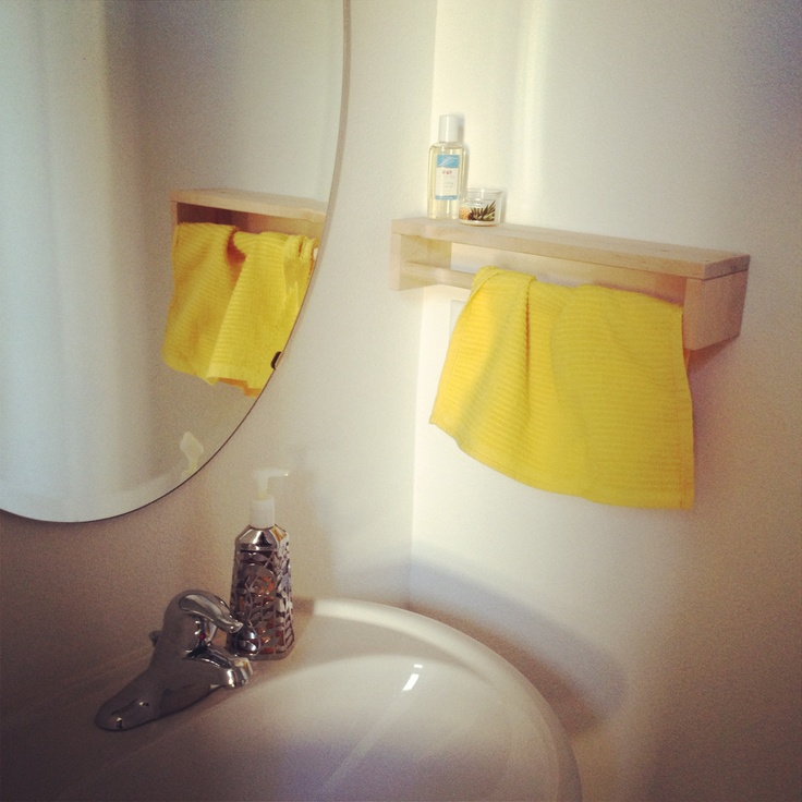 IKEA spice rack ($6) hung upside down serves as the hand towel for our .5 bath #ikeahack now just needs some paint :D