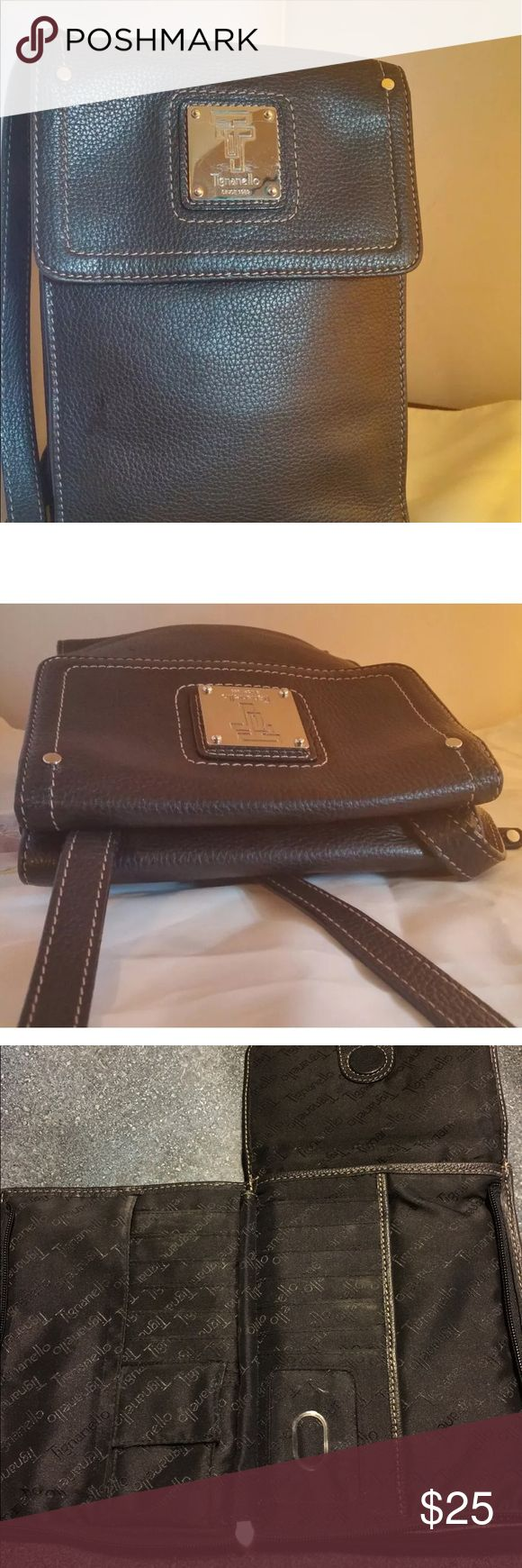 Tignanello purse CROSSBODY ORGANIZER HANDBAG BY TIGNANELLO. CRAFTED OF GENUINE TOPGRAIN PEBBLE LEATHER IN BLACK WITH LIGHT STITCHING. TIGNANELLO ENGRAVED FRONT NAMEPLATE AND ENGRAVED ZIPPER PULL IN SILVER HARDWARE. LONG ADJUSTABLE CROSSBODY STRAP. HIDDEN MAGNETIC OPEN FRONT COMPARTMENT TO PAISLEY PRINT ACCESSORIES POCKET AND BACK WALL ZIPPER COMPARTMENT. MAGNETIC FLAP AND ZIP AROUND OPEN FLAT ORGANIZER TO TIGNANELLO SIGNATURE LINING, ID HOLDER, 12 CARD SLOTS, 2 SLIPS FOR CASH OR CHECKS. SNAP…
