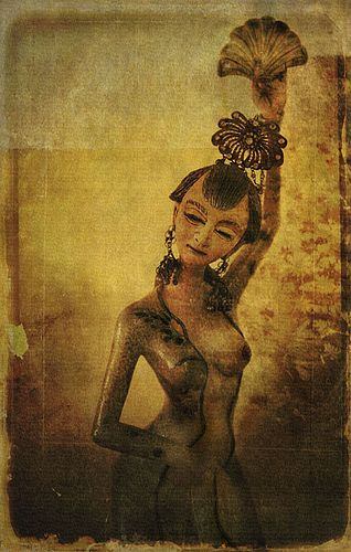Indonesian Bali Dancer - This is a still life image of an Indonesian Figurine. It's a ceramic figurine of a Bali Dancer called Ngajolpisan. I've used several layers and textures to give a more arty feel to it.