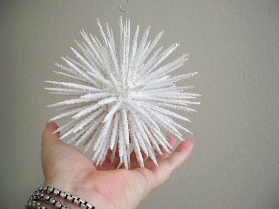 These are so pretty Shared from DIY for Witches To make them, get a small styrofoam ball. Poke with toothpicks. Spray with canned snow.